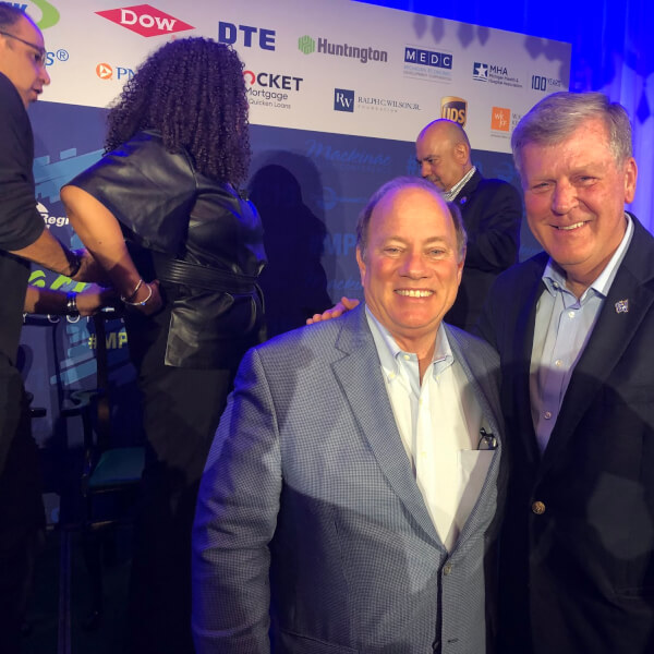 President Thomas J. Haas, left, with Detroit Mayor Mike Duggan.