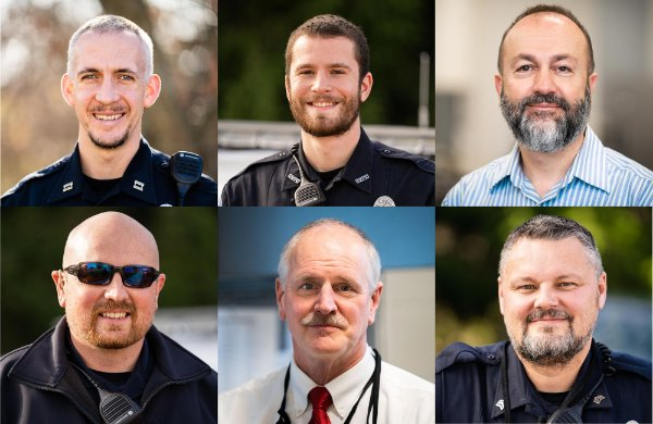 Six GVPD officers with facial hair.