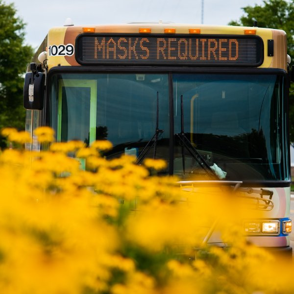 Rapid bus with sign that says masks required