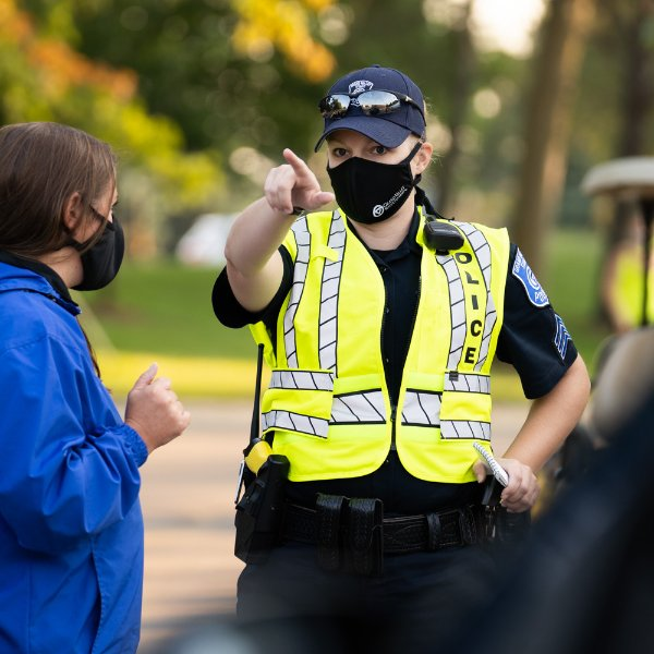 A GVPD officer directs a person during move-in