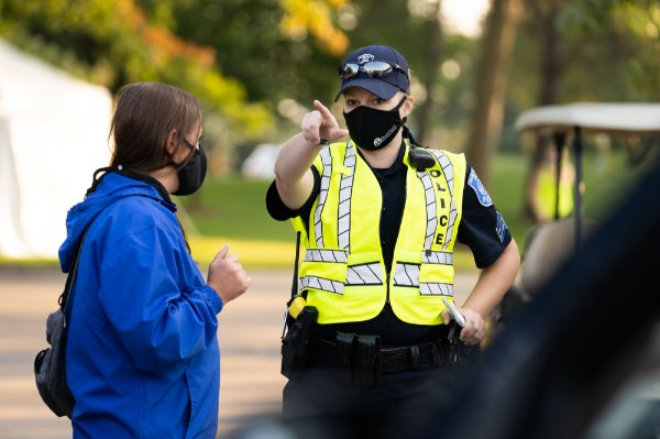 a GVPD officer directs someone with a question during move-in