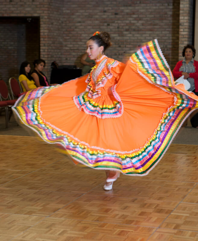 A photo of a woman performing a dance.