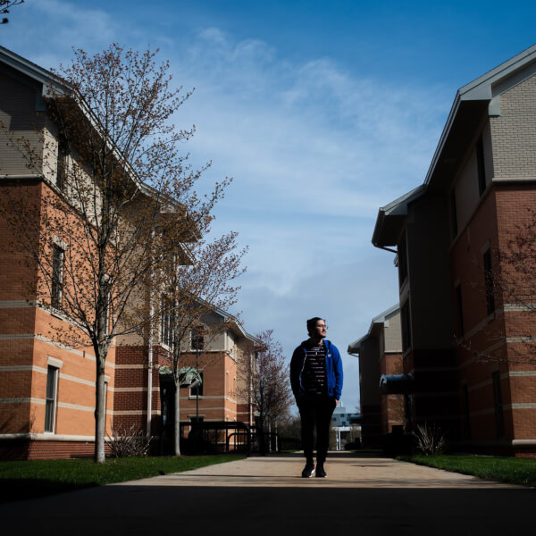 Renzo Garza Motta, a junior international student studying electrical engineering, takes a walk around his dormitory at Murray Living Center on April 28.
