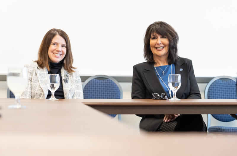 Provost Maria Cimitile, left, and Philomena Mantella, right, sit next to each other at a faculty senate meeting.
