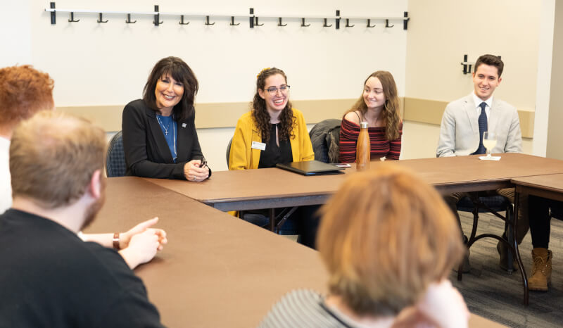 Philomena Mantella meets with student senators in the Kirkhof Center. She is seated to the left of Student Body President Rachel Jenkins.