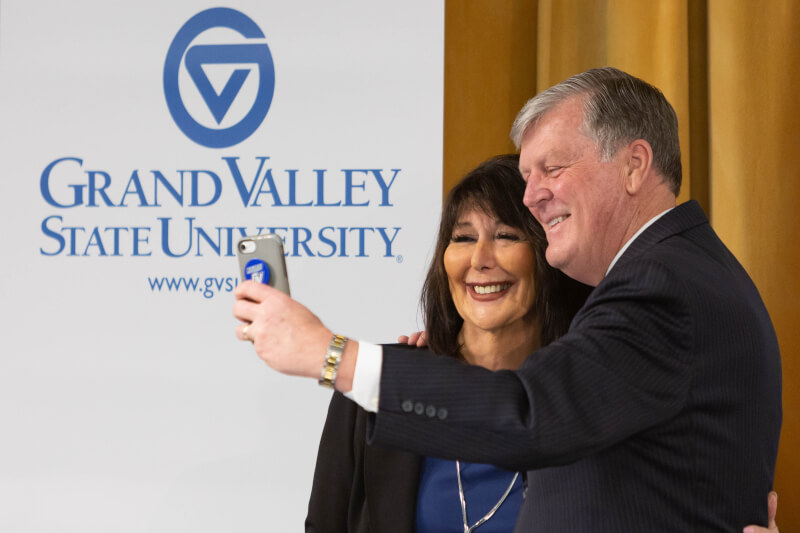 Philomena Mantella poses for a selfie with retiring GVSU President Tom Haas.