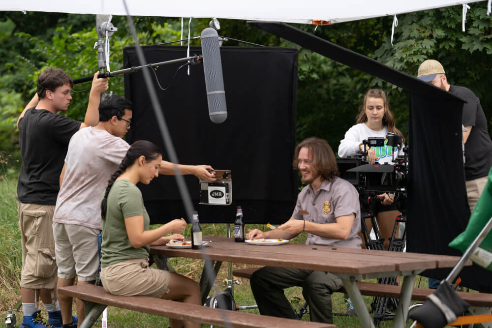 Members of the Summer Film Project crew work on a scene at Ottawa County's Hagar Park.