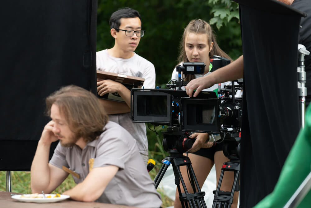 Members of the Summer Film Project crew work on a scene at Ottawa County's Hager Park.