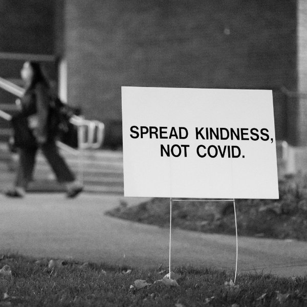 Sign on campus that says Spread Kindness, not COVID.