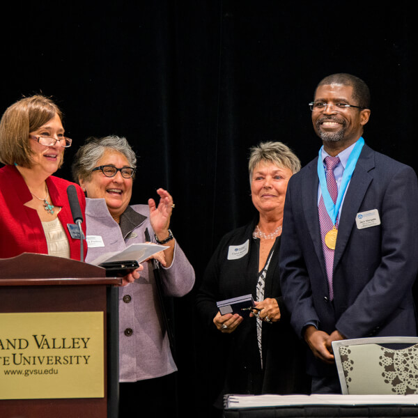 Jack Mangala, Padnos/Sarosik professor for civil discourse, will co-facilitate the third annual Civil Discourse Symposium on November 10 with Alan Headbloom. Mangala is pictured in 2015 with, from left, Anne Hiskes, Shelley Padnos and Carol Sarosik.