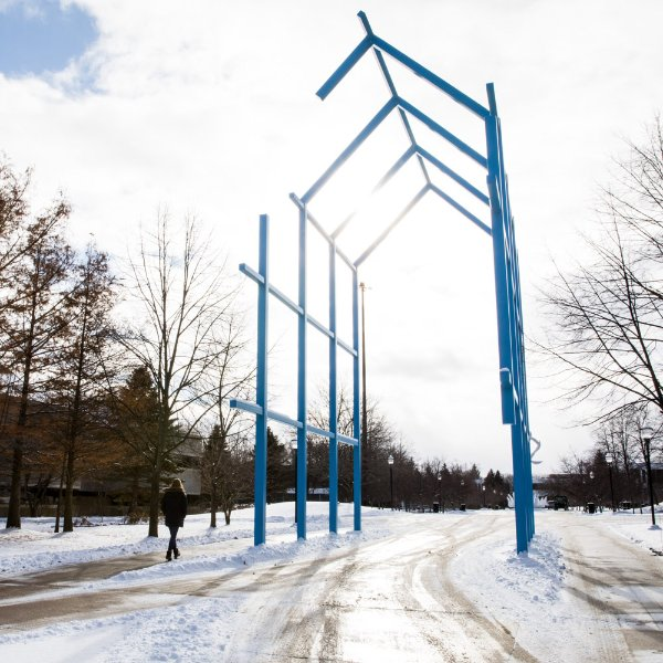 winter photo of Transformational Link sculpture on campus