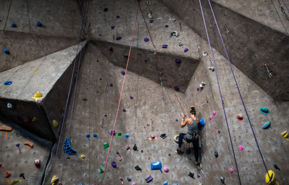 A person uses the climbing wall on Grand Valley's Allendale Campus.