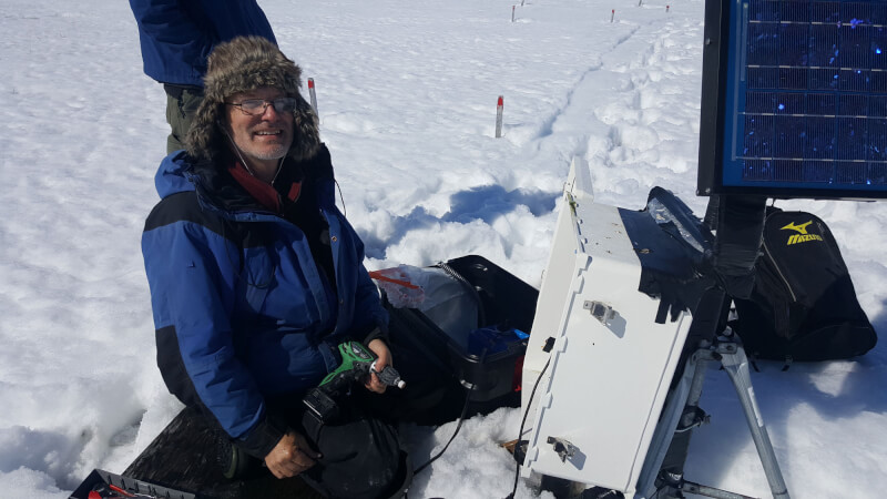 Robert Hollister, professor of biology, making repairs to data loggers in Utqiagvik, Alaska.