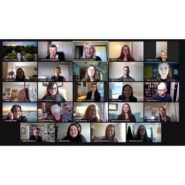 screenshot of a Zoom meeting with faces in boxes