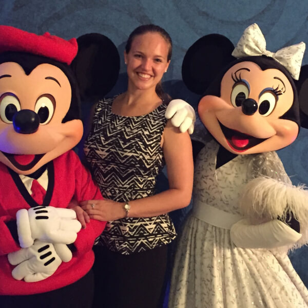 GVSU alumna Elizabeth Stolz pictured with Mickey and Minnie Mouse.