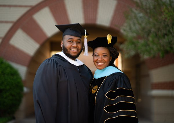 photo of Cordell Zachery and his mother, Alena Zachery-Ross, both in academic regalia