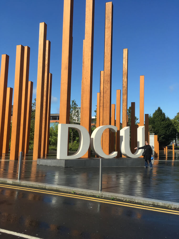 woman in front of signage at Dublin City University