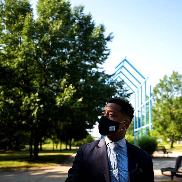 Kyle Boone, GVSU's new director housing, stands outside the Transformational Link on the Allendale Campus.