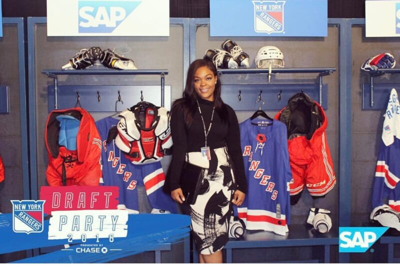 A photo of Jordan Harps in the New York Rangers locker room.