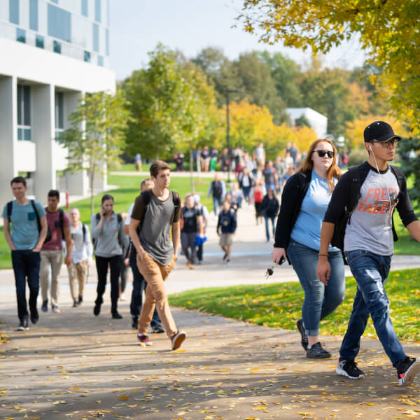 A photo of students walking on the Allendale Campus during fall.