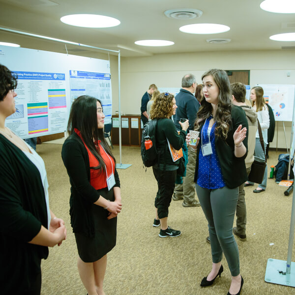 poster presentation with women talking