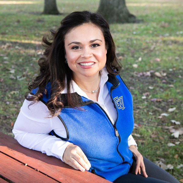 Christina Mireles portrait outside on picnic table